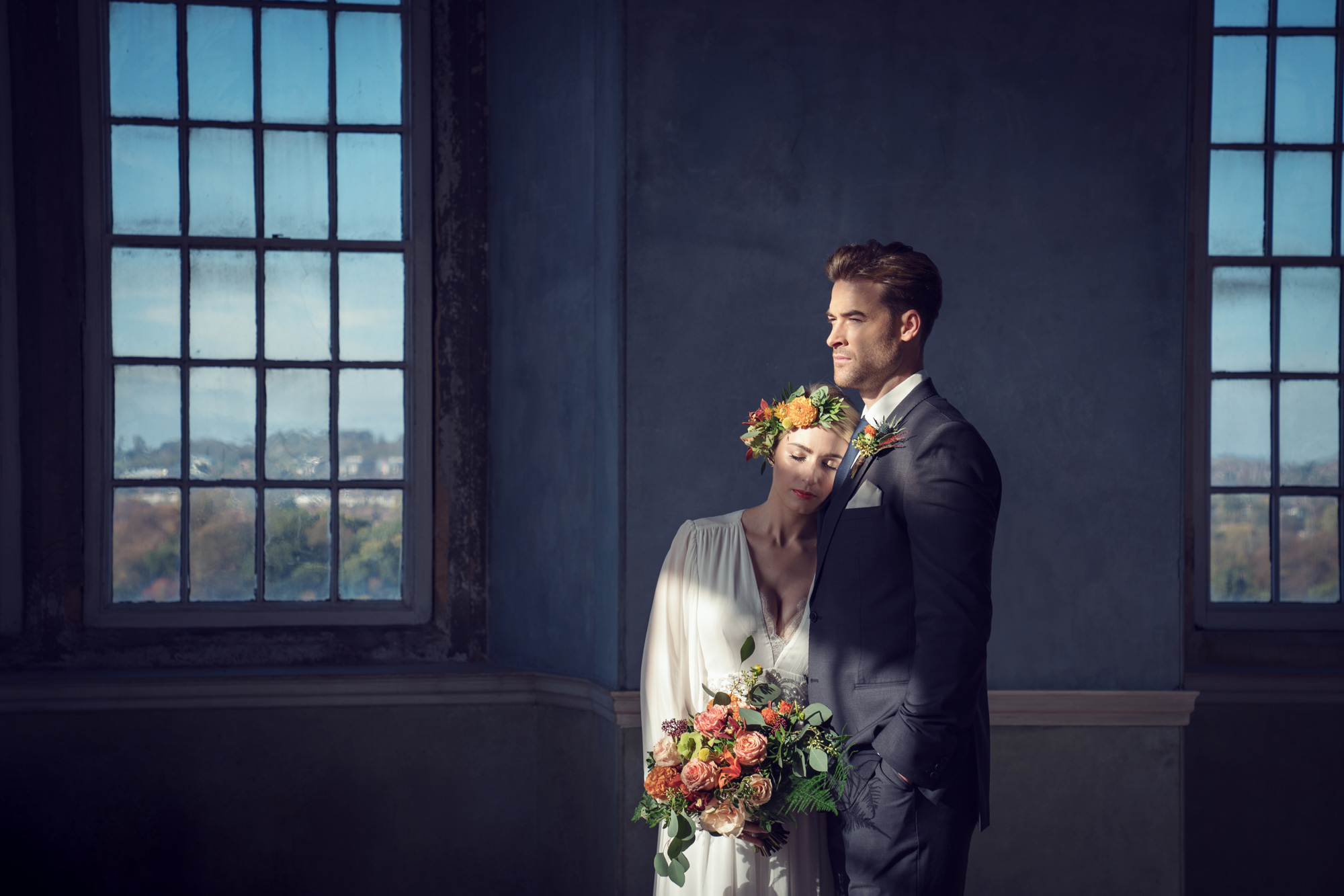 kate-hopewell-smith-sony-alpha-9-bride-and-groom-pose-formally-in-front-of-a-window-after-the-ceremony
